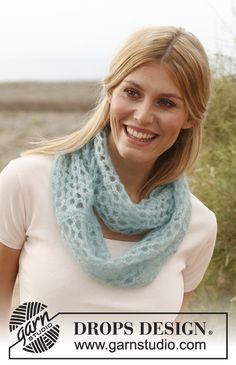 "Knitted DROPS neck warmer in ""Vivaldi""."