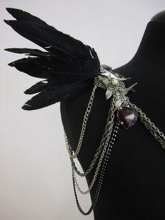 RAVEN Black lrg feather epaulet w/  spikes and heart gems.. $235.00, via Etsy.