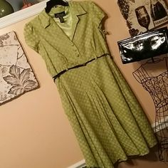 Vintage 1950's style dress size 16. Lime Green Lime Green polka dot 1950's style dress in a size 16. A lined with pleating and flared.  Belted waistline.  Dress comes without belt. Lime Green with lighter polka dots.  Capped sleeves.  There's a side zipper moreso for definition.  Knee length or a little below depending on your height. Dress is fully lined.  60 % cotton and 40 % polyester. In great preloved condition. R B Collection Dresses Midi