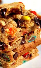 M&M Chocolate Chip Cookie Bars Recipe – soft and chewy cookie bars packed with gooey chocolate and bright and colorful M&Ms! All done in under 30 minutes!