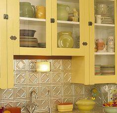 Faux tin tile backsplash in chrome(ish)   finish. |  watersidecottagestyles.com