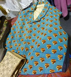 We're in love with this fox adorned waistcoat. It is in the collection of extile collector and historian Graham Hunter as part of his collection of 18th and 19th Century embroidered waistcoats.