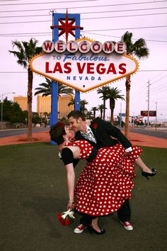 Las Vegas wedding... how stinkin cute is this??? With the cute red dress! I WANT ONE LIKE THIS OF US WHEN WE GET MARRIED BUT IN A WHITE DRESS THOUGH