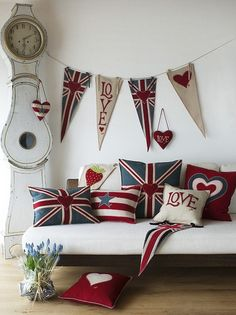 Union Jack decor. A different take on red, white and blue! |England|red,white,blue|pillows|decorate|interiordesign|Swedish clock|