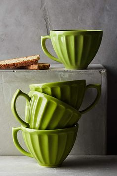 Add green accents to your kitchen by using bright green crockery against neutrals