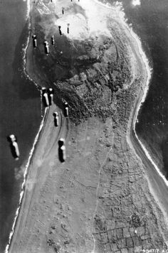 This is a nice reproduction of an original WWII photograph showing bombs from a USAAF Bomber falling on Iwo Jima. Size of photo is about x Bombing Iwo Jima. History Online, World History, World War Ii, Military Photos, Military History, Batalha De Iwo Jima, Battle Of Iwo Jima, Ww2 Photos, War Machine