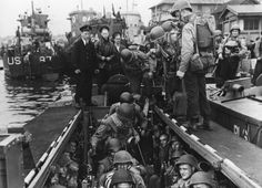 American troops board a landing craft in preparation for crossing the English Channel to invade Normandy