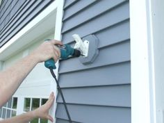 How To Attach A Flag Pole To Vinyl Siding Attaching a flag pole bracket to vinyl siding is an easy home improvement project that will allow you to show your patriotism on your home. However, if you don't do it correctly it's likely you'll damage your siding. This project can be done in just a…
