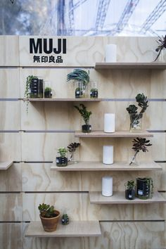MUJI Pop-Up / flexible display. Melbourne Spring Fashion Week, 2014. Murray Barker. timber. Tasmanian Oak dowel screen + pegs. Plywood shelving.