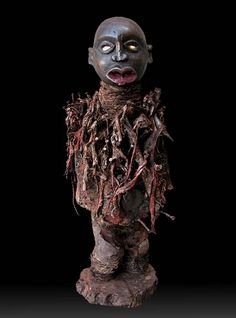 "KONGO / Yombe: Lower Zaire  Democratic Republic of the Congo  Magical statue ""nkondi""  Wood, iron, vegetable fibers, glass pieces  mirror, cosmetic red earth, kaolin,   sacrificial material of a different nature. -  African Art-Africart-Art-Africain African Art-Tribal-Art Masterpieces-Kongo"