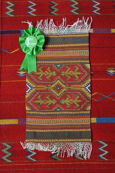 This miniature tapete is woven from wool and silk. Teotitlan del Valle, Oaxaca Mexico