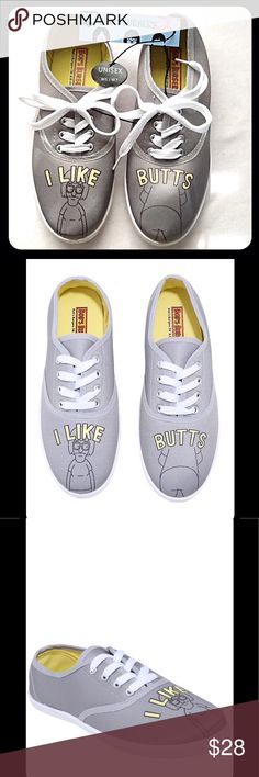 """Bob's Burgers  I Like Butts, Tina Lace-Ups  NWT What does Tina Belcher like? Well, besides horses and zombies? Butts, duh! These grey sneakers are a testament to her obsession. The toes feature Tina Belcher, and a butt, alongside the phrase """"I like butts."""" Grey lace-up closure and white outsoles. Man-mad materials.  Imported.  This Pair Only.  NWT Bob's Burgers Shoes Sneakers"""