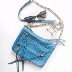 Rebecca Minkoff 5 Zip Bag Sky blue leather Rebecca Minkoff crossbody. In good condition. Minor scuffs but not highly noticeable. The inside is in EUC, looks hardly used. Rebecca Minkoff Bags Crossbody Bags