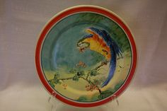 Catalina Island Pottery cold painted plate - Macaw on limb with berries. Painted by Chase.