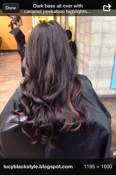 Black hair with brown peek-a-boo highlights.