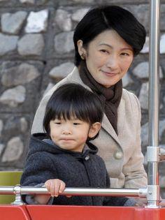 Japan's Prince Hisahito of Akishino (L) and his mother, Princess Kiko (R) ride the solar-powered miniature train at the Kodomo no Kuni (Children's Land) in Yokohama