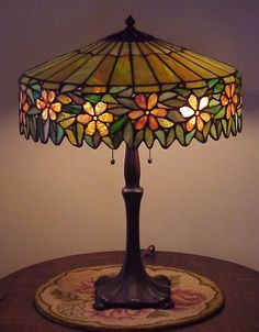 When searching for a lamp for your house, your choices are nearly unlimited. Get the perfect living room lamp, bedroom lamp, table lamp or any other type for your specific room. Stained Glass Rose, Stained Glass Lamps, Stained Glass Patterns, Leaded Glass, Stained Glass Windows, Antique Lamps, Vintage Lamps, Antique Art, Crushed Glass