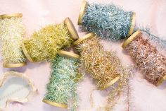 TINSEL GARLANDS  No home is complete without these tinsel garlands during this holiday season. The gorgeous muted metallic tones are sure to set you apart from the crowd. Try it out and see for yourself; the truth is in the tinsel!  www.whitelilacinc.com To SHOP this item click the visit button!
