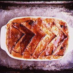 Bread and Butter Pudding Served with Clotted Cream and Compote of Apricots Recipe | SAVEUR
