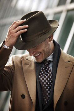 Cashmere coat, hat, stunning tie and a smile. This is one stunning combination! Very cool. #NerdMentor