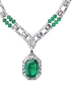 CARTIER - VIRACOCHA NECKLACE Platinum, one cushion-cut emerald (26.60 carats) from Colombia, one cut-cornered triangular step-cut diamond (2.02 carats), emerald beads, calibré-cut diamonds, brilliant-cut diamonds. The emerald pendant can be removed.