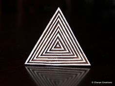 This lovely wood stamp features a geometric triangle motif, beautifully hand carved on the wood block. The stamp is 2.9 inches (74 mm) by 2.5 inches (64 mm) and 1.5 inches (3.8 cms) thick. (Each side of the triangle is 2.9 inches)