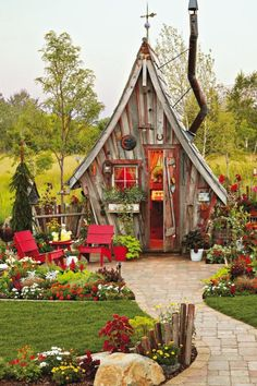 This garden shed is unlike anything we've ever seen! Dan Pauly designed this unusual shed, with its distinctively crooked chimney and… shed design shed diy shed ideas shed organization shed plans Fairy Houses, Play Houses, Garden Cottage, Home And Garden, Verge, She Sheds, Shed Plans, Little Houses, Dream Garden