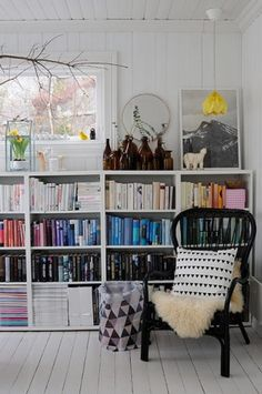 homes - norway house: white room with bookshelves and black chair