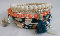 Blauwe bloemenband +3 elastische armbanden.