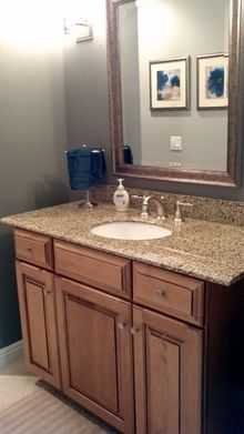 Downstairs guest bathroom with travertine floors and marble countertops.
