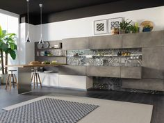 Wooden kitchen with cement finish doors OLTRE by Cucine Lube