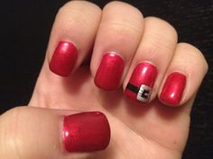 Christmas Nails... Red with Santa buckles on ring fingers.