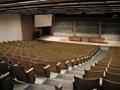 Old school large lecture hall. Those hard wooden seats, the tiny desk not built for left handers, and look up on the front of the room-- better than a snoring PowerPoint is a chalked up blackboard.