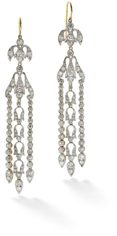A pair of late 19th century diamond pendent earrings  The old brilliant-cut diamond foliate surmount suspending a similarly set diamond foliate drop, to a central articulated line of diamond-set stylised tulip motifs, between two outer lines of diamonds, all terminating in pear-shaped, old brilliant-cut diamond drops, millegrain-set throughout, length 9.5 cm.