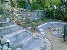 Backyard stairs! The backyard is wicked steep.  Where the stairs are located used to be a hill of moss with 18' square pavers cut into the hill to make stairs. Stair risers ar made from cinder block (most of which were found in the huge rock pile in the background there) capped with the 18' pavers. The rest of the stones were gleaned from the crumbling rock walls and the property and dry stacked. The stairs were back filled with 1/4' crushed granite leftover from last year's garden project.