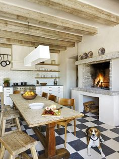 Mediterranean Style With Rustic Fireplace: A wood-burning fireplace designed for cooking adds Mediterranean charm to this eat-in kitchen.
