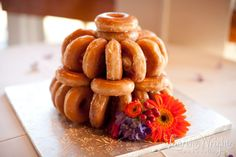 Donuts instead of a Groom's Cake - This is one of those yummy guilty pleasures that your groom and wedding guests are sure to devour! Display the donuts on a cake stand or work them into a fun shape. Either way, they are sure to be a crowd pleaser!