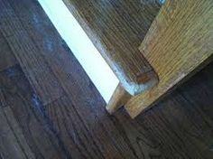 There is raw exposed wood, big gouges, dents and scratches. Most hardwood floors have a 15-20 year warranty on the finish.