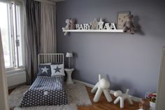 Understated Nordic style girl's room in grey and white.