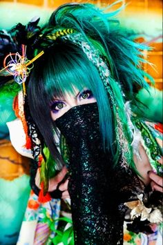 Kujo Takemasa (九条武政) is the guitarist and leader of the Japanese Visual Kei band, Kiryu and its alter-ego, My Dragon as Beauty Tama. His image color is green.