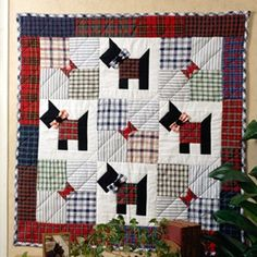 """Scottie Dogs Quilting ePattern - Number of Designs: 2 - Pillow & Wall HangingApproximate Design Size: Pillow 14"""" x 14"""" without ruffle & Wall Hanging 34"""" x 34""""Designer: Leisure Arts StaffOriginal Publication: Leisure Arts Book #102637, Quick-Method Quilts, Book 1 Skill Level: Intermediate†Description: You'll see results in no time when you quilt our adorable pillow and wall hanging. As the foundation for both projects, the Scottie quilt block is easily rotary cut, and our quick grid technique…"""