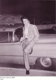 with Elvis leaning against his light blue 1954 Cadillac Fleetwood, the car Scotty, Bill and D.J. used on the March-April 1957 tour.