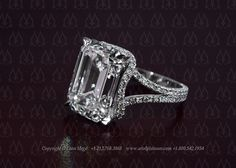 Emerald cut diamond engagement ring by Leon Mege. The cool thing is that there is no gallery - the culet is open from the back! The halo is almost hidden when viewed from the top.