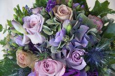A luxurious wedding bouquet of Antique shaded Roses Silverstone, Memory Lane & Amnesia, Purple Lisianthus, Eucalyptus, Eryngium Thistle, Freesia, Poppy Seed Heads, Albiflora Bruneii, Classic Hydrangeas, Oak Leaves and Herbs.