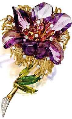 GEM-SET AND DIAMOND BROOCH - designed as a stylized flower with carved amethyst petals, the pistils set with marquise-shaped tourmalines and brilliant-cut diamonds, to the yellow gold thread fringes, the stem accented with brilliant- and single-cut diamonds and tourmaline leaves