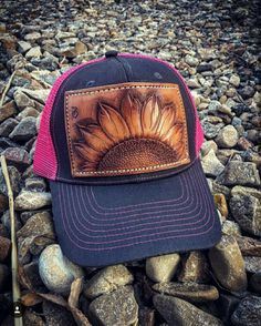 Hand tooled sunflower leather patch on a mesh snap back cap. Colors  Available  Black Pink 4ae8025ad7a6