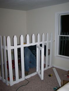 """Dog """"crate"""" in the corner of our bedroom. Picket fencing with swing gate used."""