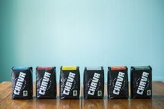 Here's the entire lineup of bags I designed for Chava Coffee Co. Logo is custom type, bright white on matte black bags.   Great organic, fair-trade coffee at www.chavacoffee.com  (Photo by @Hunter Sprague)