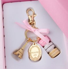 Macarons Effiel Tower keychain   http://www.aliexpress.com/item/Cake-macaron-fashion-keychain-France-LADUREE-Macarons-Effiel-Tower-Best-Gift-Christmas-gifts-wedding-birthday-gift/1603589598.html