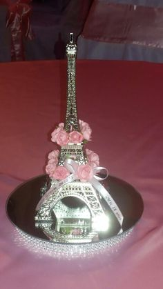 Eiffel Tower centerpiece with flowers Paris Theme Centerpieces, Paris Party Decorations, Eiffel Tower Centerpiece, Quinceanera Decorations, Quinceanera Party, Paris Quinceanera Theme, Paris Sweet 16, Sweet 15, Paris Themed Birthday Party